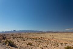 Free Glimpse Of Snow On A Mountain Ridge, New Mexico Desert Under Brilliant Blue Sky Stock Photo - 182196600