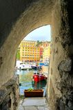 Glimpse of a seaside village. Colorful town on Liguria, Italy called Camogli with boats and buildings stock photography