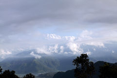 Glimpse of Snow covered Annapurna range Royalty Free Stock Photo