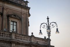 City hall in Noto, Sicily, Italy. Glimpse of the terrace of the famous town hall with streetlight, baroque sicily stock image