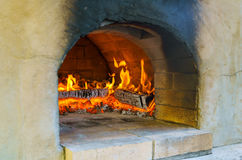 Glimpse wood fire oven before the pizza comes in Royalty Free Stock Images
