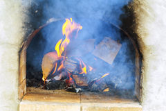 Glimpse wood fire oven before the pizza comes in Stock Photo