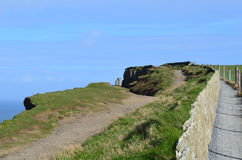 Glimpses of the Lookout Tower on The Cliff`s of Moher Stock Photo