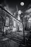 Église fantasmagorique avec la lune Image stock