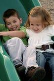Glissement des enfants de mêmes parents 3 Photos libres de droits