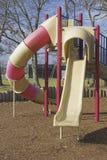 Glissière de la cour de jeu des enfants Image libre de droits