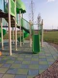 Glissière moderne de terrain de jeu d'enfants Image libre de droits