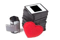 Glissières avec la cartouche de film au-dessus du fond blanc photo libre de droits