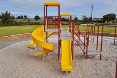 Glissière de terrain de jeu d'enfants Photo libre de droits