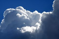 GLISTENING BILLOWING WHITE CLOUDS royalty free stock photo
