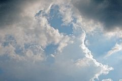 GLISTENING CLOUDS IN BLUE SKY stock images
