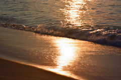 Glistening and Golden Waves at Sunrise Royalty Free Stock Images