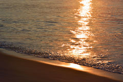 Glistening and Golden Waves at Sunrise Royalty Free Stock Photos