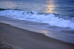 Glistening and Golden Waves at Sunrise Stock Image