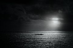 Glistening sea in a full moon night Stock Photos