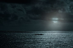 Glistening sea in a full moon night Stock Image
