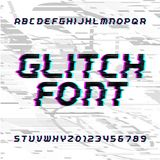 Glitch alphabet font. Distorted type letters and numbers on a bright glitched background. Royalty Free Stock Image