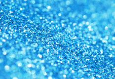 Glitter abstract. Closeup image of blue glitter wrapping paper Stock Photo