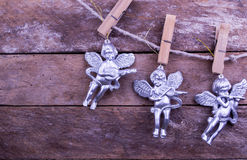 Glitter Angel Christmas toys on wooden background Stock Photos