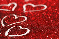 Glitter background with hearts Stock Image