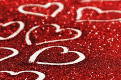 Glitter background with hearts Royalty Free Stock Images