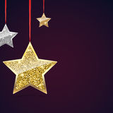 Glitter Background with Silver and Gold Hanging Stars. Royalty Free Stock Photo