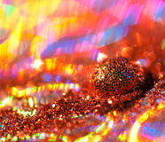 Glitter ball. Ball of glitter against a colorful background Stock Image