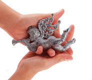 Glitter Christmas Angel toy in hands Stock Photos