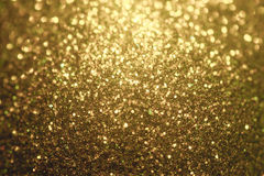 Glitter christmas background, shiny texture, Gold sparkle background. Glitter christmas background with sparkles, shiny stars, colored Stock Photo