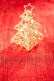 Glitter christmas tree decoration on golden red background Royalty Free Stock Photography