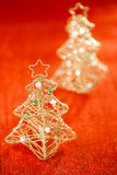 Glitter christmas tree decoration on golden red background Stock Photography