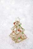 Glitter christmas tree decoration on white snow background Stock Image