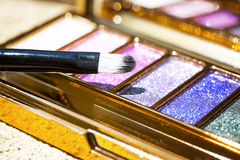 Glitter colored  shadow palette  make up with brush Royalty Free Stock Photos