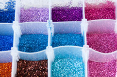 Glitter. Different colors glitter nail decorations in a box royalty free stock images