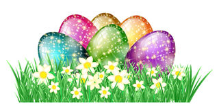 Glitter easter eggs in grass Royalty Free Stock Photos