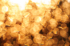 Glitter festive christmas lights background. light and gold defo Stock Image