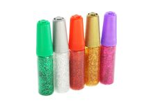 Glitter glue. Five tubes of glitter glue of various colors on white background Stock Photos