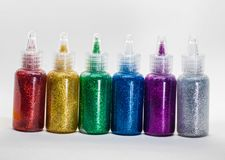 Glitter glue bottles royalty free stock photography