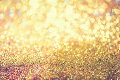 Glitter gold bokeh Colorfull Blurred abstract background for birthday, anniversary, wedding, new year eve or Christmas.