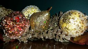 Glitter and Gold. A  Christmas table arrangement of holiday pears Royalty Free Stock Images