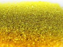 Glitter gold dust and sand background for christmas greeting cards. And New year banners for dreamy holidays and noel eve royalty free stock photography
