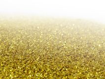 Glitter gold dust and sand background for christmas greeting cards. And New year banners for dreamy holidays and noel eve royalty free stock photos
