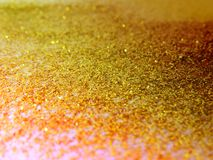 Glitter gold dust and sand background for christmas greeting cards. And New year banners for dreamy holidays and noel eve royalty free stock photo