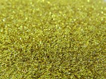 Glitter gold dust and sand background for christmas greeting cards. And New year banners for dreamy holidays and noel eve stock photography