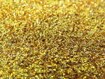 Glitter gold dust and sand background for christmas greeting cards. And New year banners for dreamy holidays and noel eve stock images