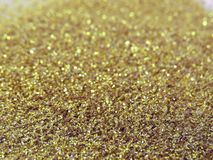 Glitter gold dust and sand background for christmas greeting cards. And New year banners for dreamy holidays and noel eve stock image