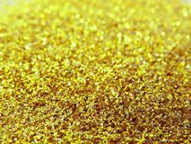 Glitter gold dust and sand background for christmas greeting cards royalty free stock image
