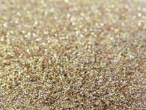 Glitter gold dust and sand background for christmas greeting cards. And New year banners for dreamy holidays and noel eve stock photos