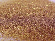 Glitter gold dust and sand background for christmas greeting cards stock photography