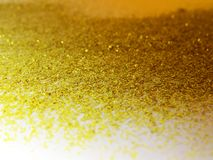 Glitter gold dust and sand background for christmas greeting cards. And New year banners for dreamy holidays and noel eve royalty free stock image